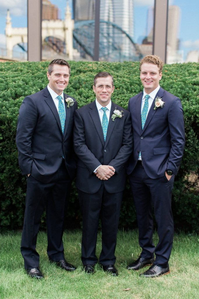 Groom with groomsmen outside the Grand Concourse