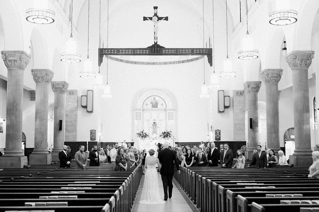 Bride walking down the aisle in black and white at St. Anselm Catholic Church - 1920's inspired wedding Grand Concourse