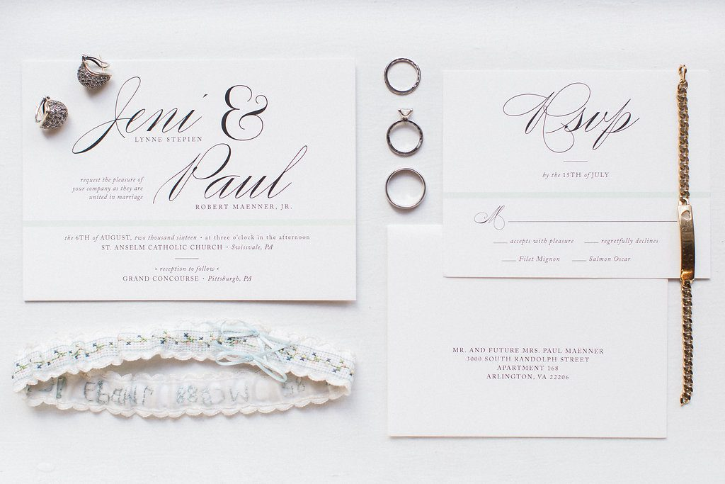 Invitation suite from minted styled with bridal jewelry and rings