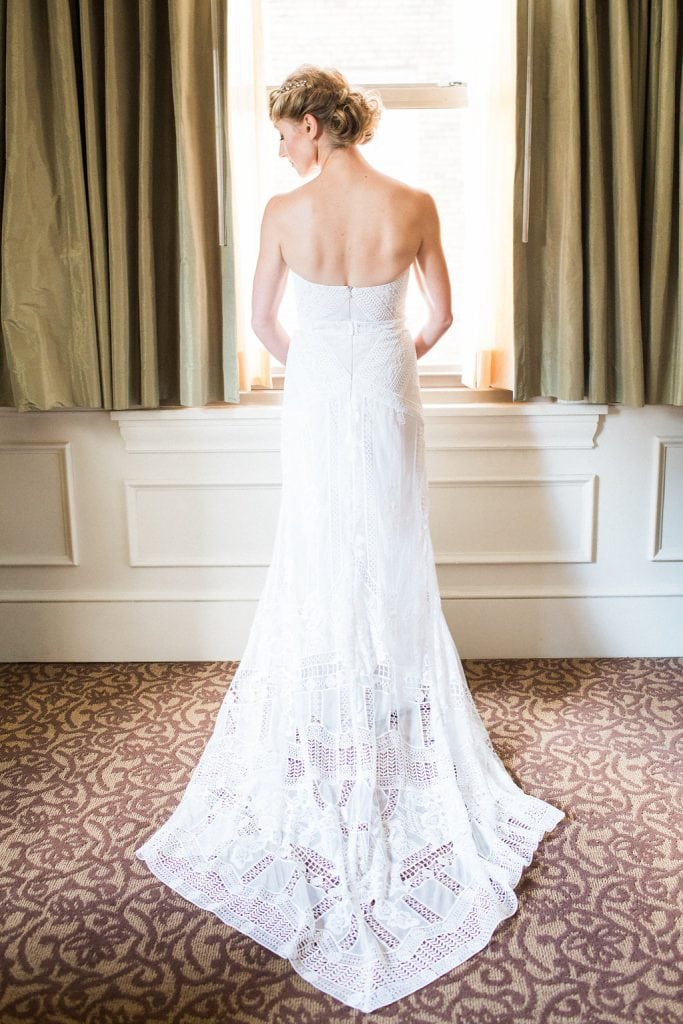 Bride getting ready at the Omni William Penn in Rue de Siene Wedding Dress