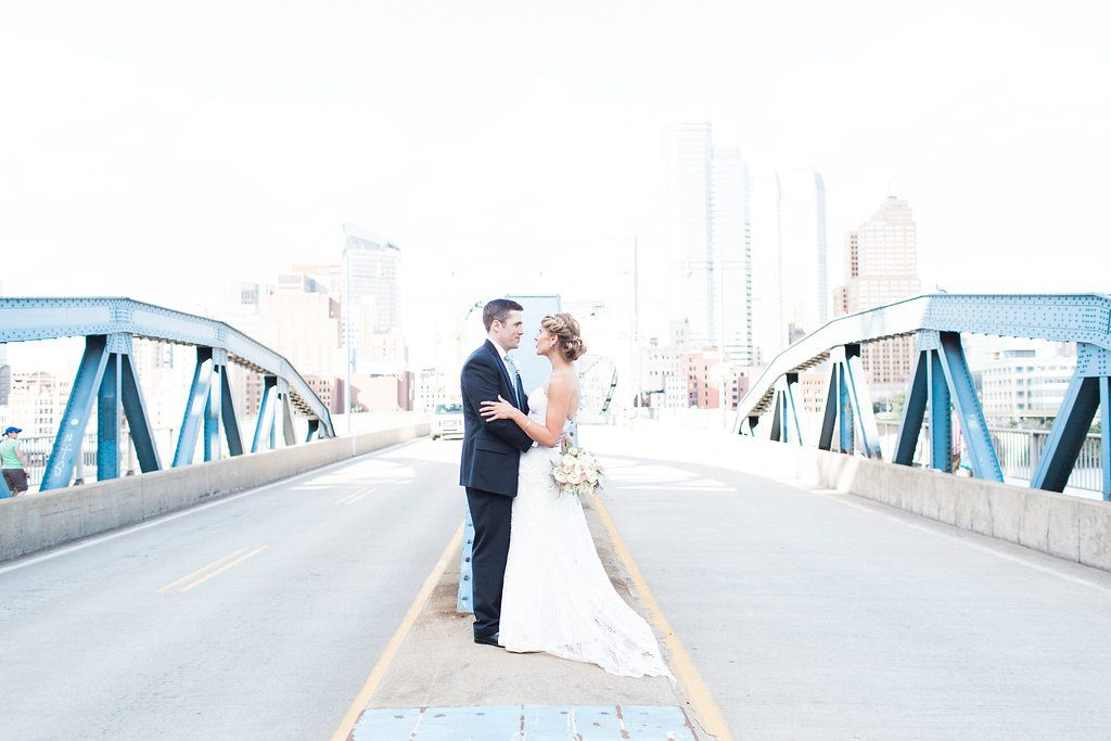 Photo of the bride and groom standing on Smithfield Street Bridge