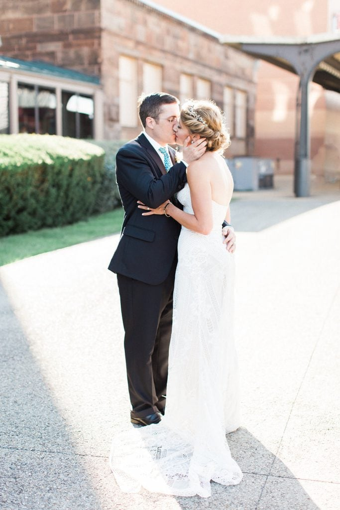 Photo of the bride and groom kissing outside the Grand Concourse at Station Square