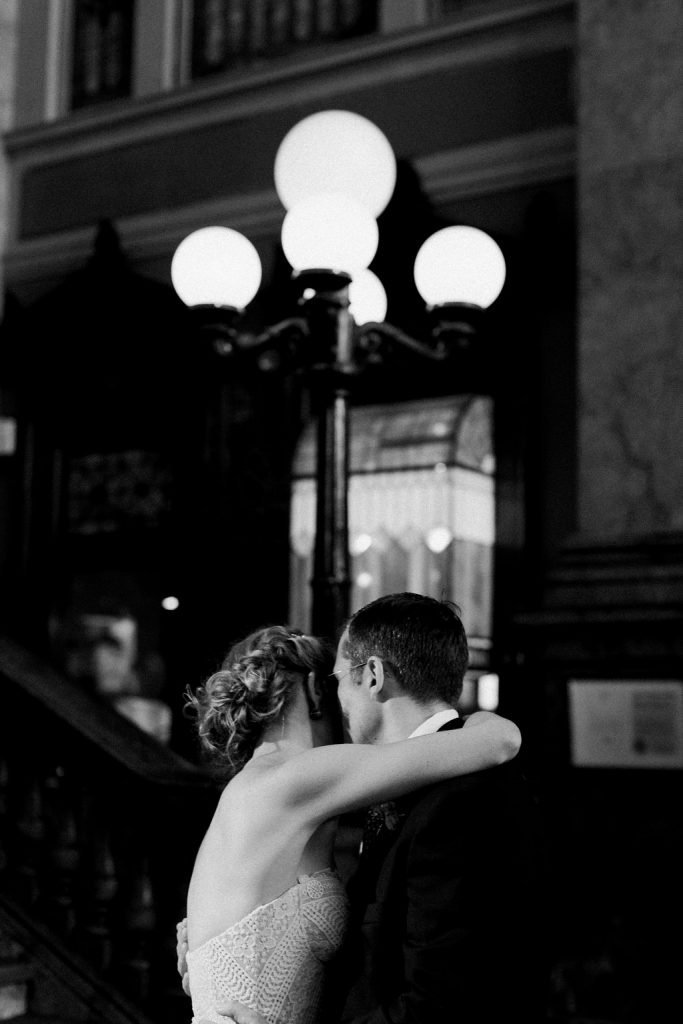 Bride and Groom share their first dance during their wedding reception at the Grand Concourse Station Square Black and white photo
