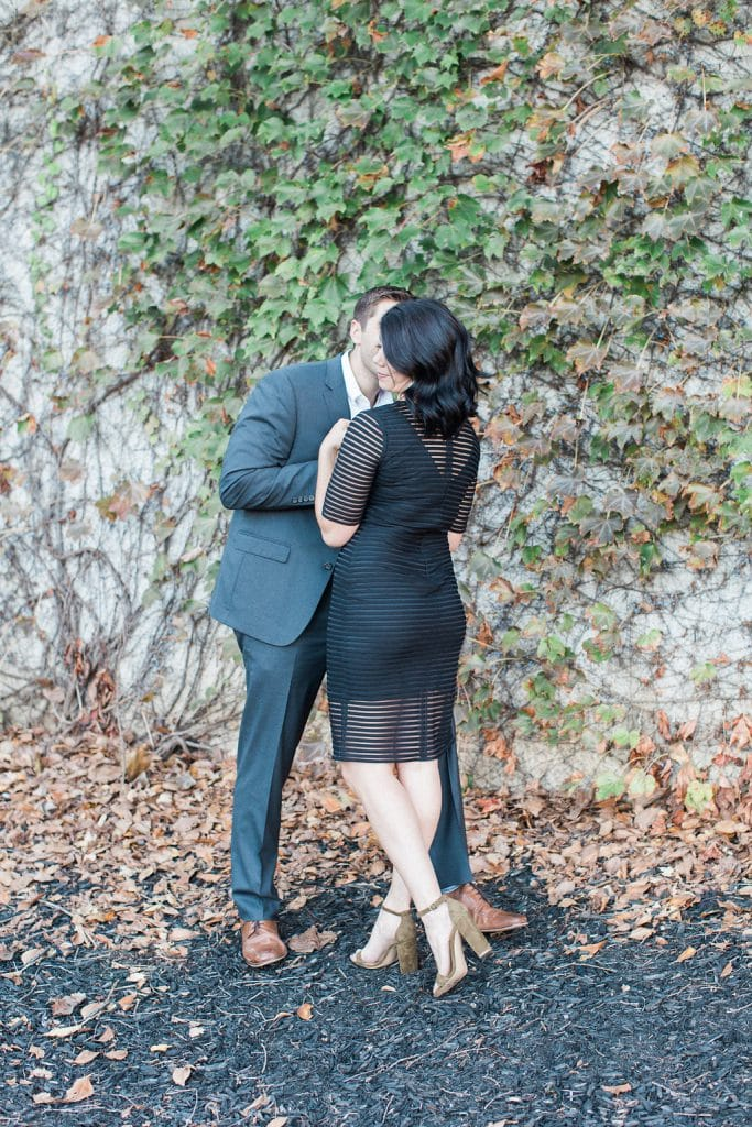 Groom kissing the bride's cheek during engagement photos