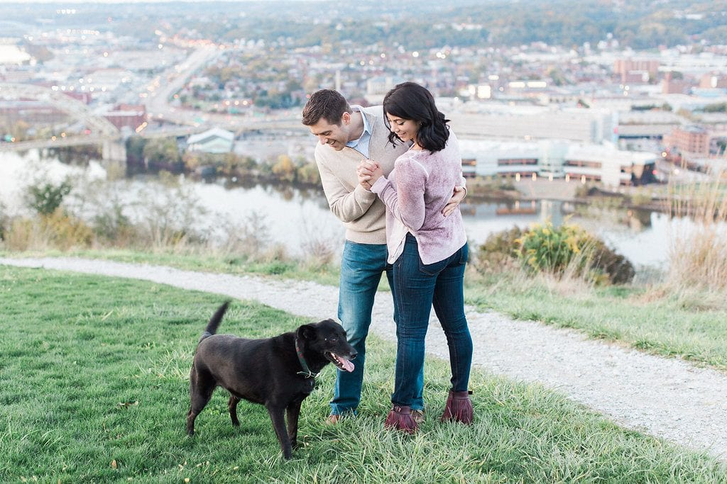 Mount Washington and South Side Engagement Engaged couple on mount Washington over looking Pittsburgh dancing with their dog