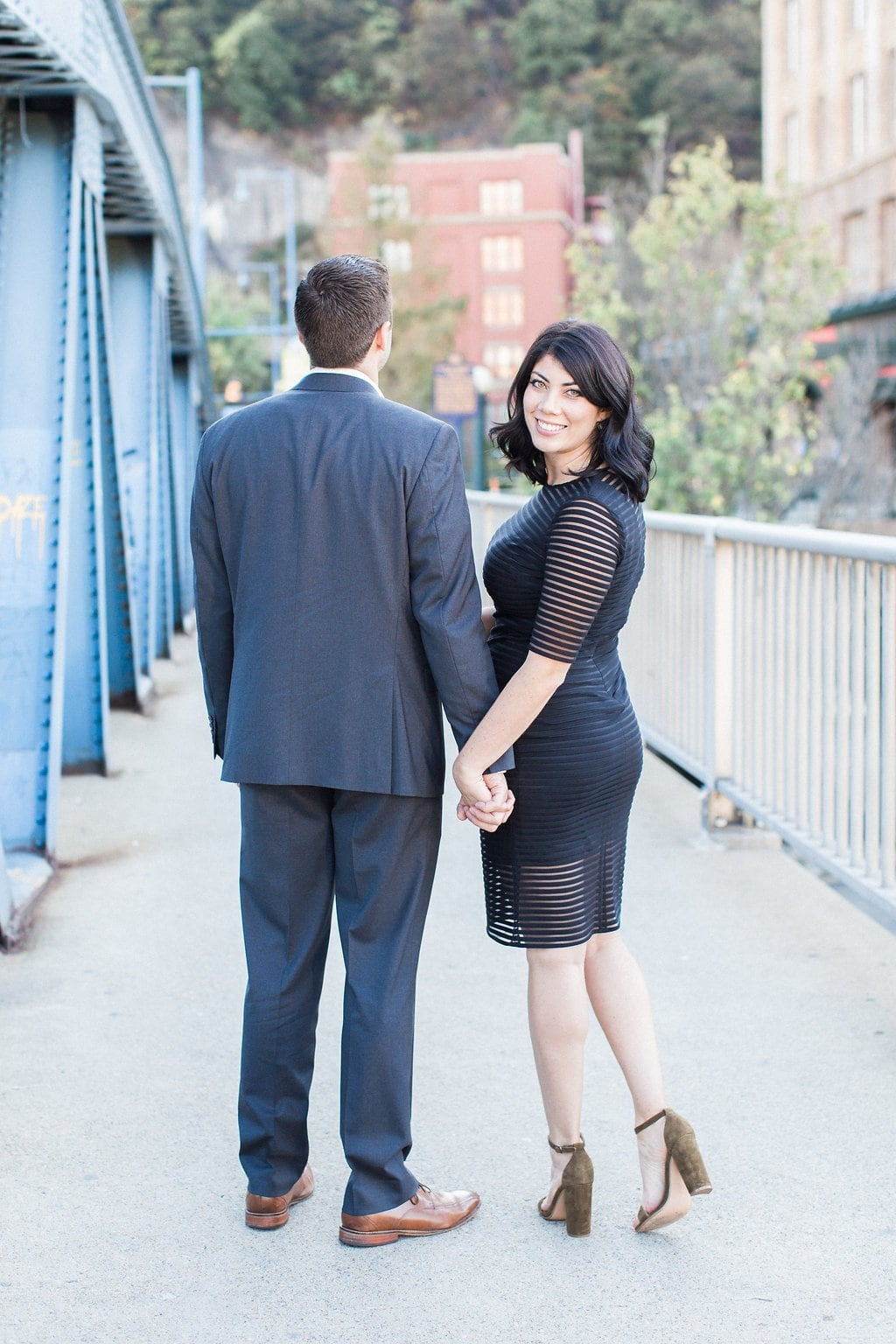 Bride and groom on Smithfield Street Bridge in Pittsburgh - Mt. Washington & South Side Pittsburgh Engagement Photography