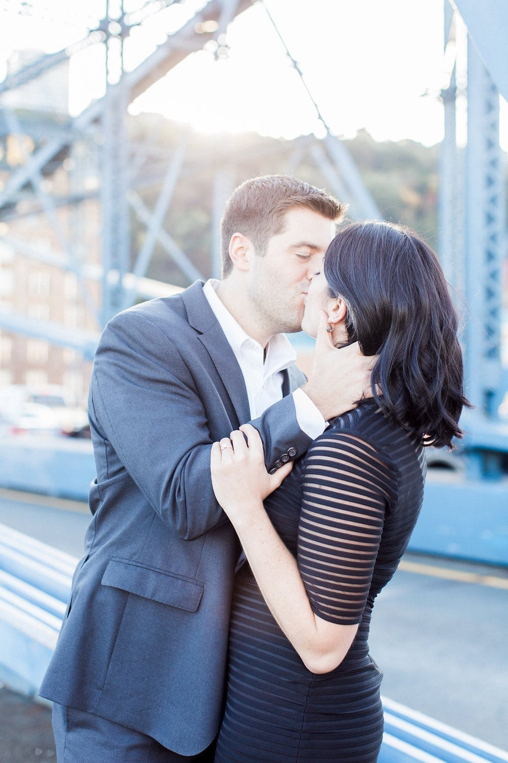 Couple kissing on the Smithfield Street Bridge - Mt. Washington & South Side Pittsburgh Engagement Photography