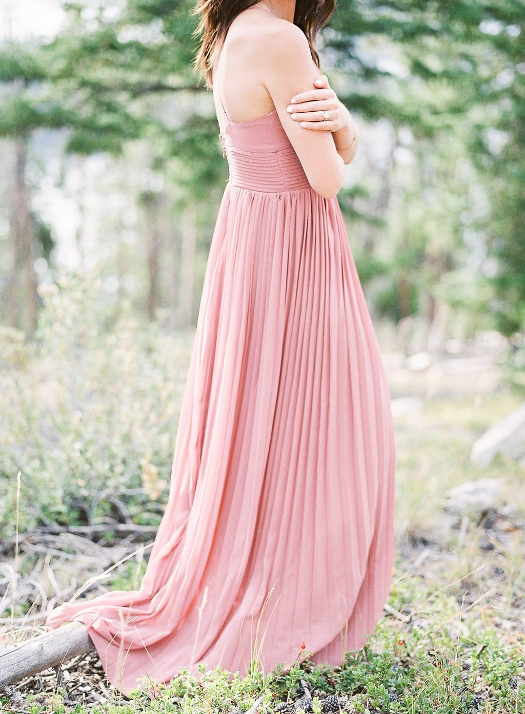 Bride standing in the aspen trees wearing pink dress