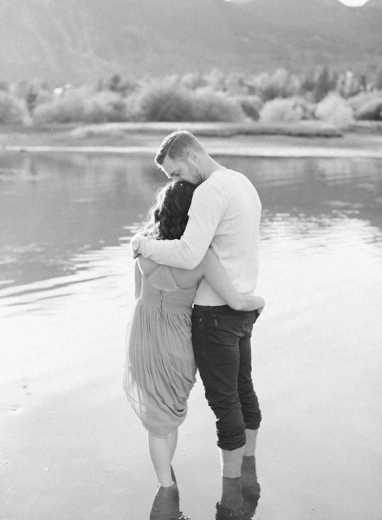 Lake Dillon Colorado Engagement Photography bride and groom standing in lake kissing