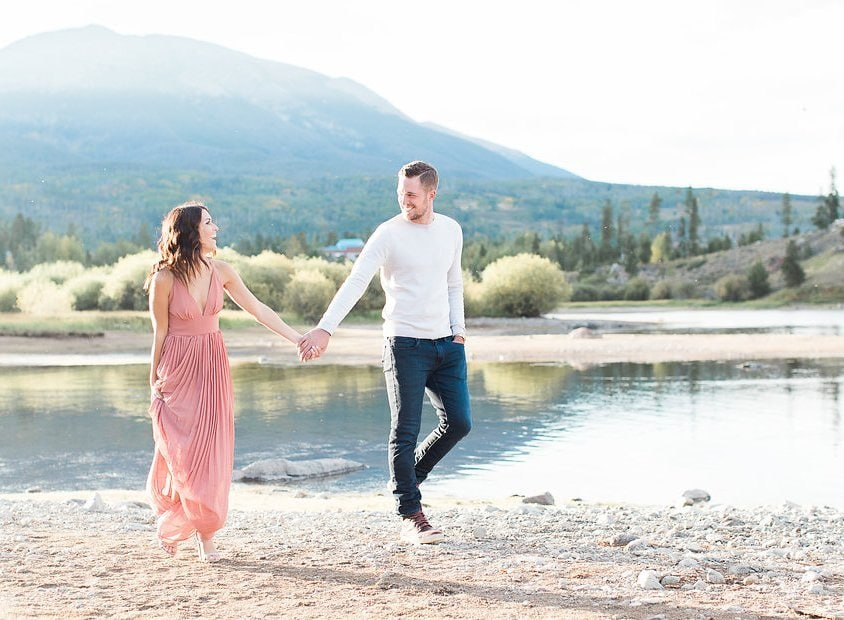 Lake Dillon, Colorado Engagement Photography groom and bride walking together holding hands
