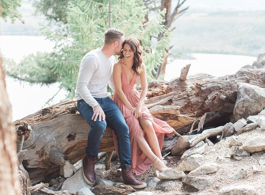 Lake Dillon Colorado Engagement Photography groom whispering into the bride's ear making her laugh