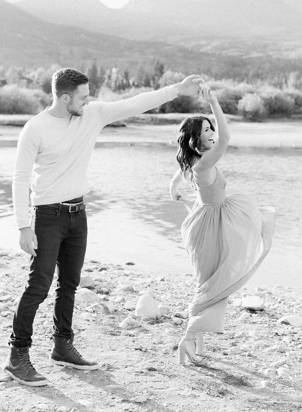 Lake Dillon, Colorado Engagement Photography groom dancing with his bride