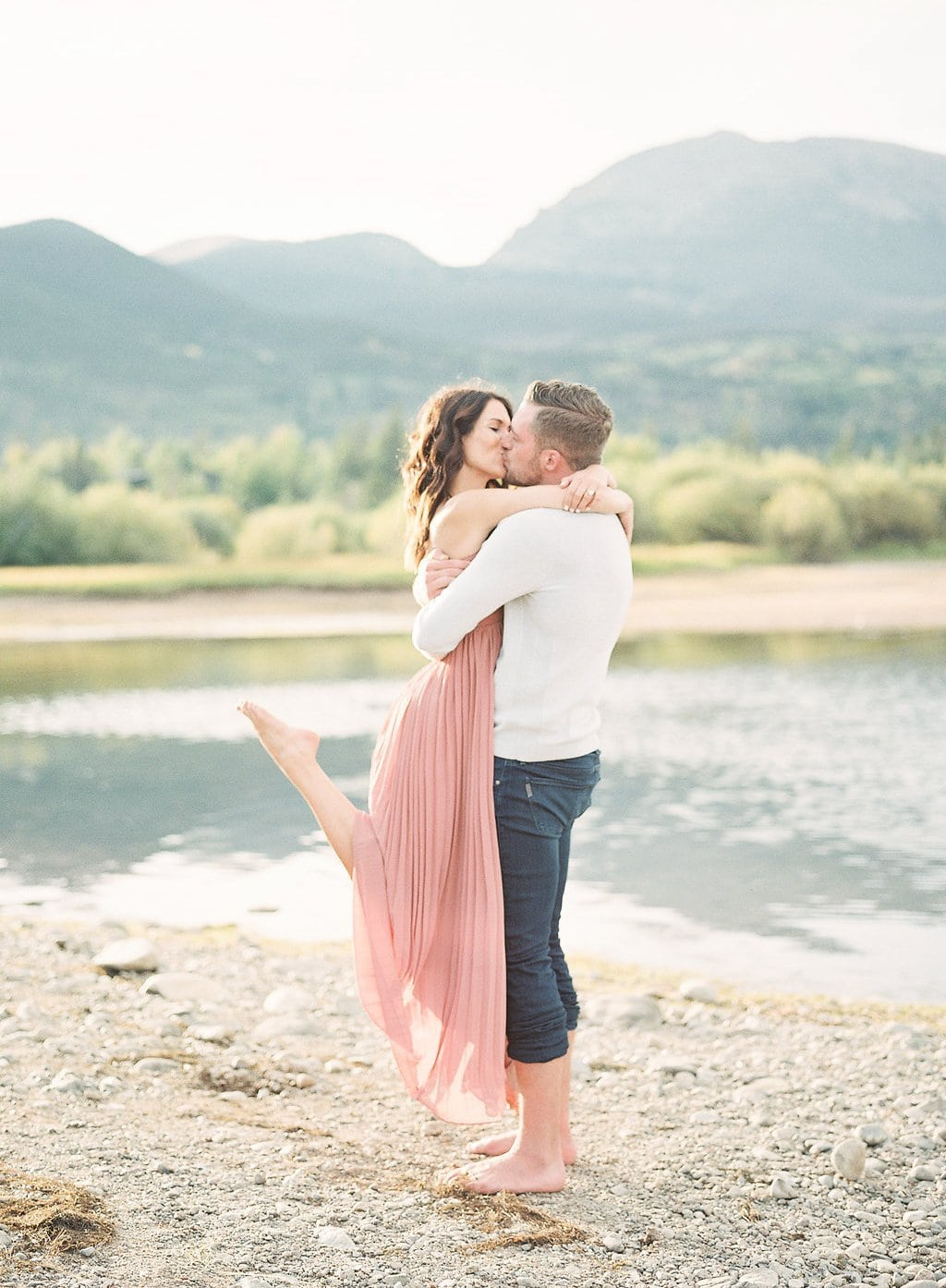 Lake Dillon, Colorado Engagement Photography Bride picking up groom near lake