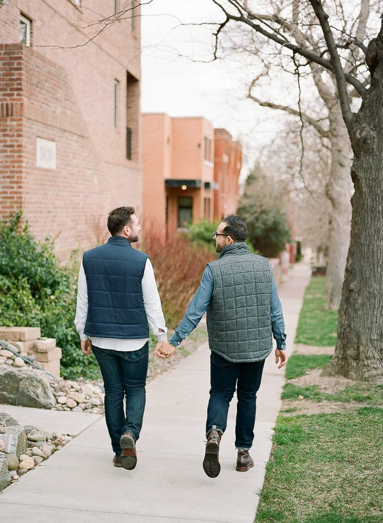 Estes Park Engagement Photography Session - two gay men walking and holding hands in denver