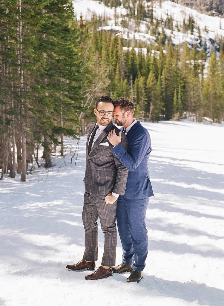 Estes Park Engagement Photography Session - two men embracing in the snow in the mountains in suits