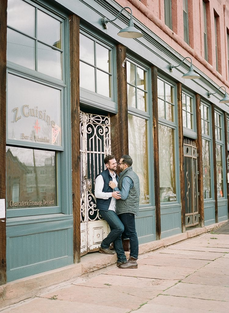 Estes Park Engagement Photography Session - gay couple posing on the streets of downtown denver