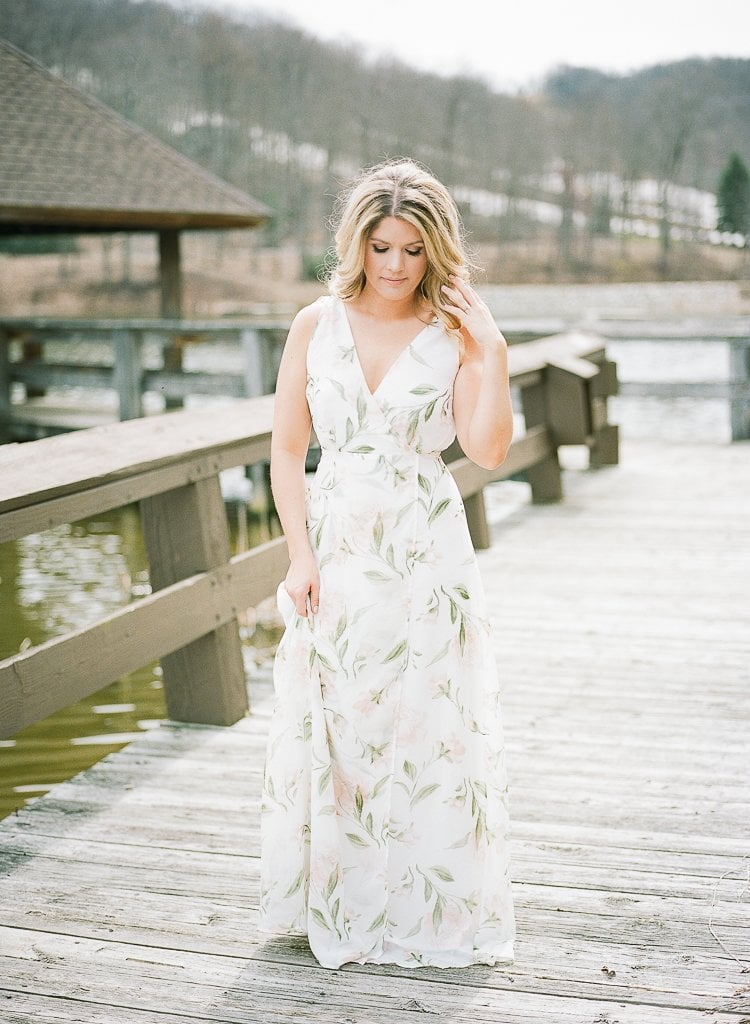 Seven Springs Engagement Photography - bride posing and playing with hair on a dock