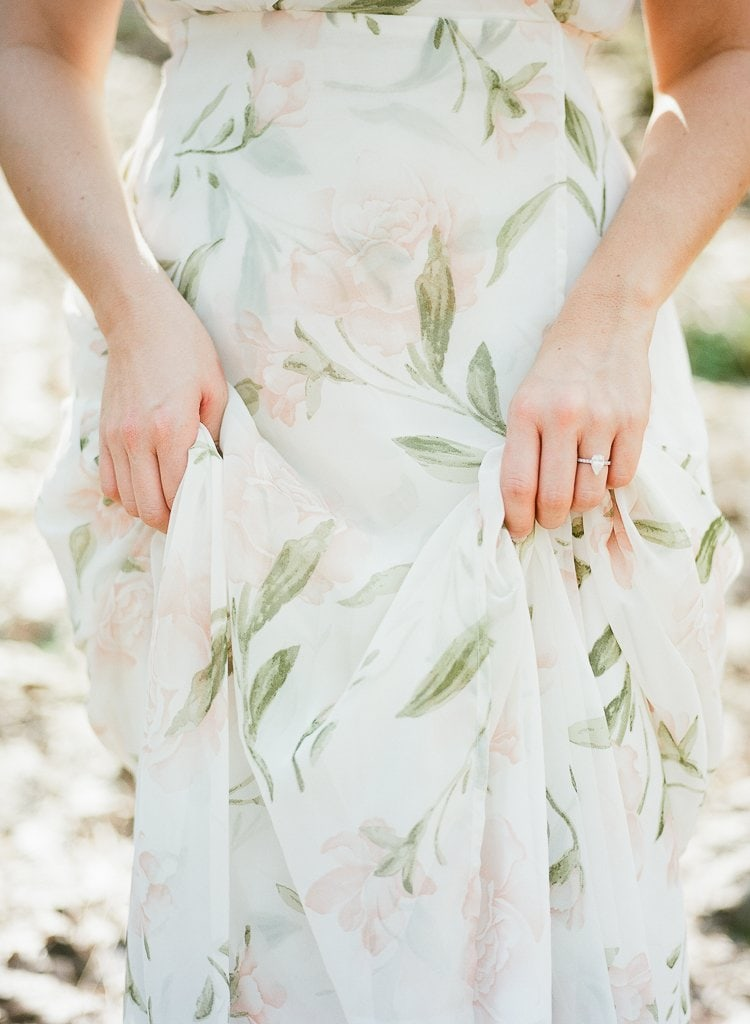 close up of bride's hands holding her dress