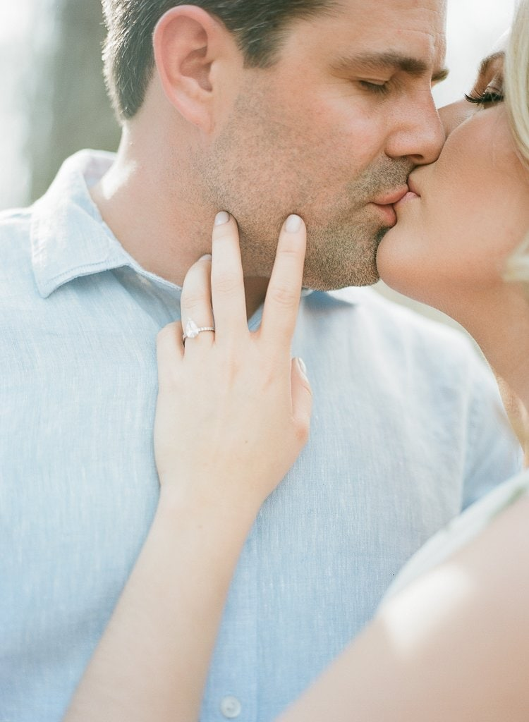 Seven Springs Engagement Photography - bride and groom passionately kissing in the woods