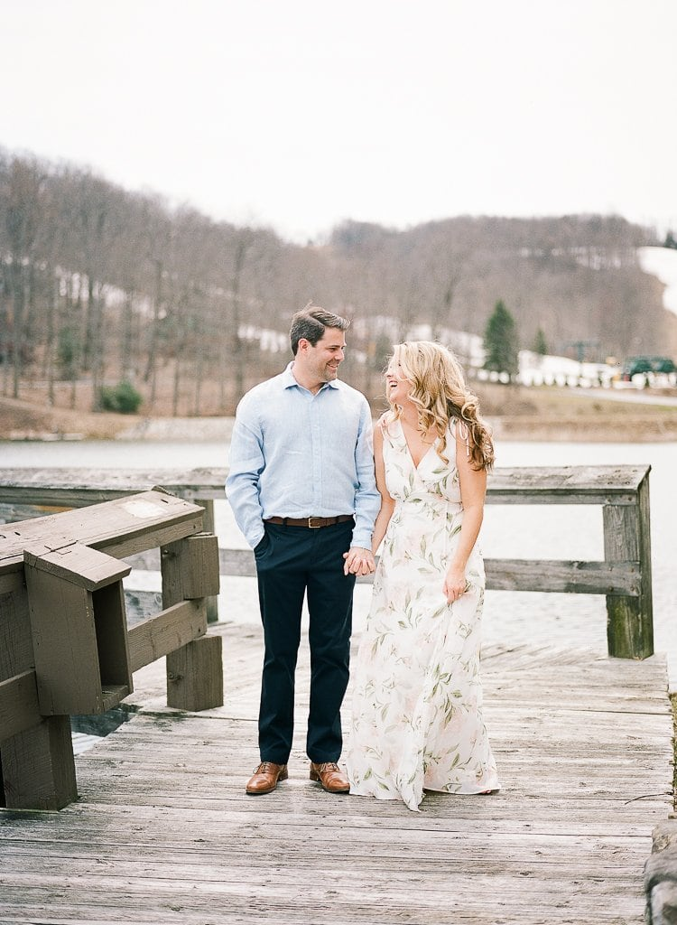 Seven Springs Engagement Photography - Bride and Groom holding hands on a dock