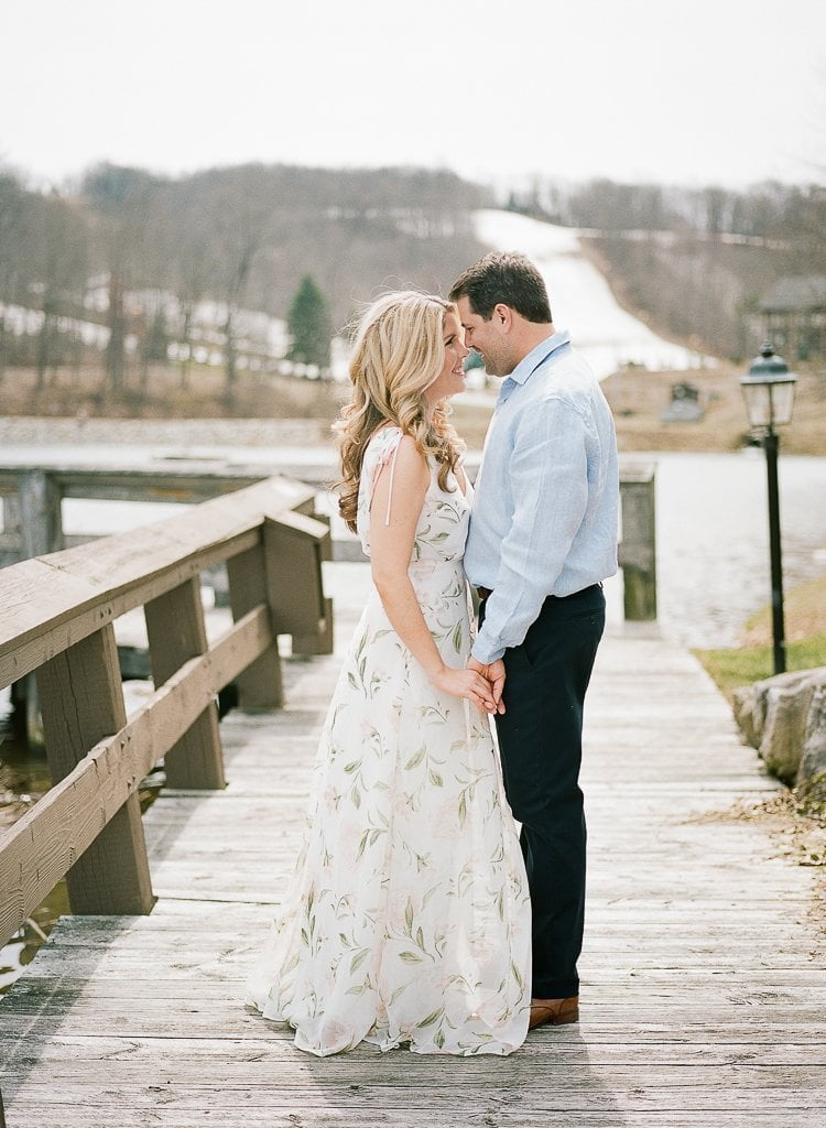 Seven Springs Engagement Photography - bride and groom holding hands together on a boardwalk