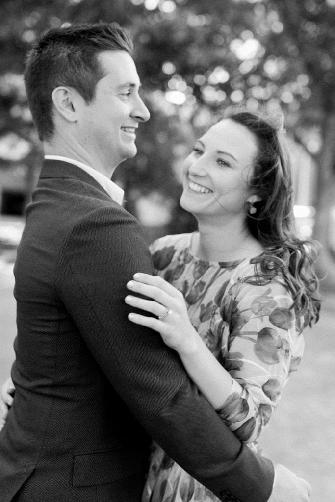 Black and white photo of couple laughing during engagement photos
