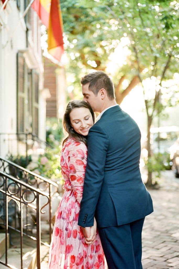 couple embracing during engagement photos in Old Town Alexandria