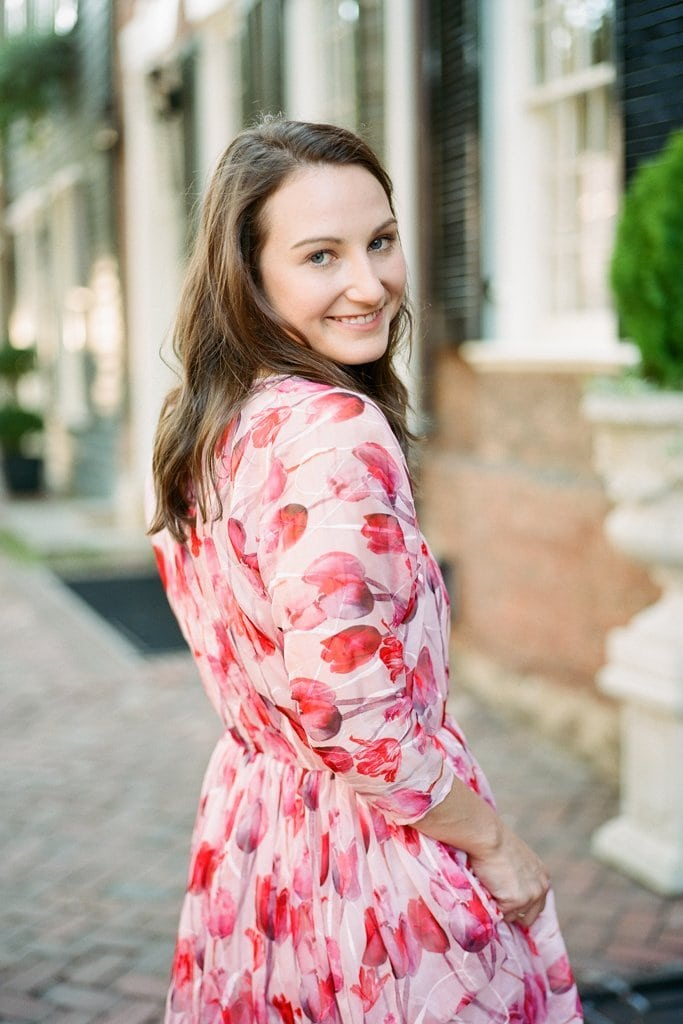bride in beautiful red and pink anthropologie dress during engagement photos - Engagement Photography Session in Old Town Alexandria, Virginia