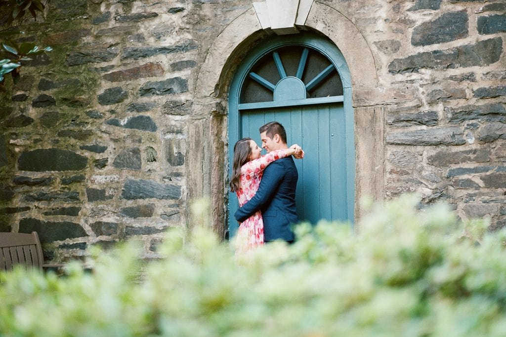 Engagement photos at the Carlyle House in Alexandria Virginia couple standing by the blue door