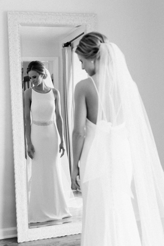 The Pennsylvanian Wedding bride getting ready in Mikaella by Paloma Blanca dress