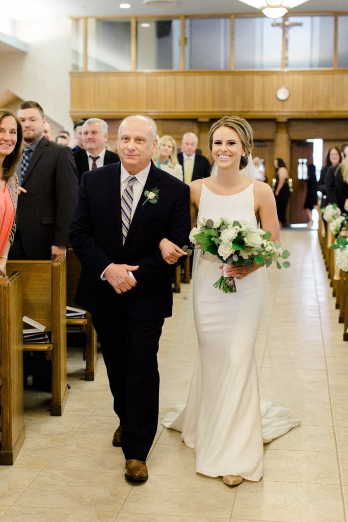 The Pennsylvanian Wedding bride walking down the aisle at St. Bede's Church - White and Gold Wedding at The Pennsylvanian