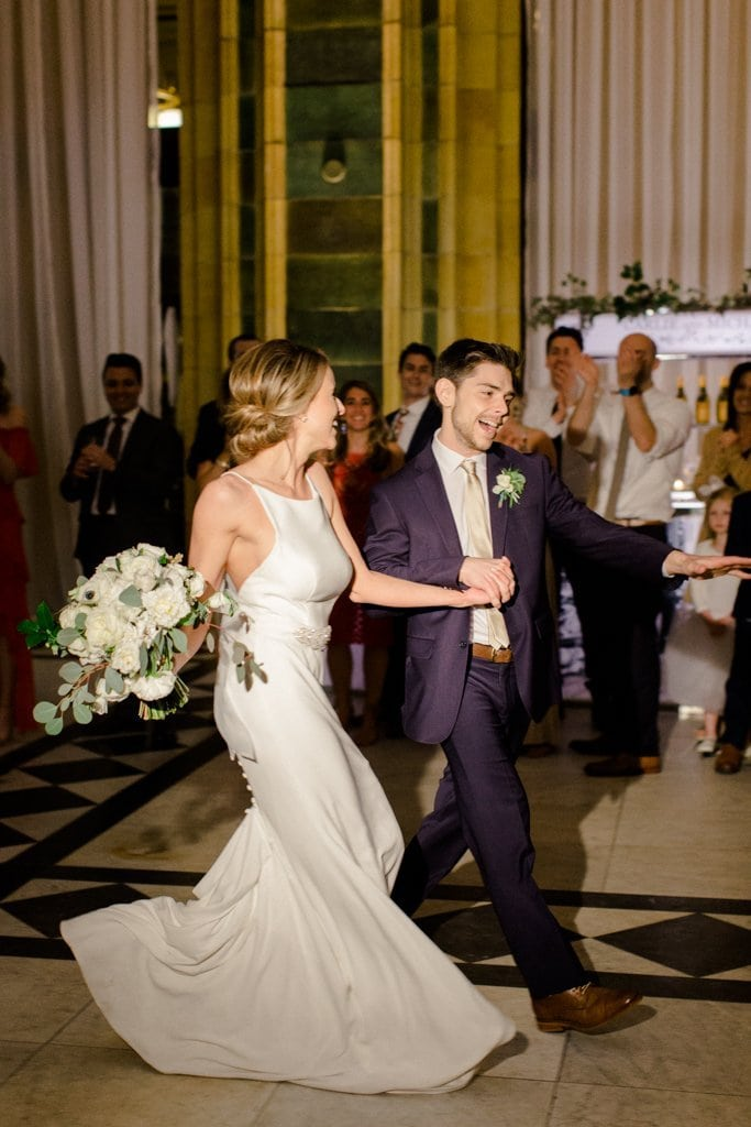 The Pennsylvanian wedding bride and groom enter and share first dance- White and Gold Wedding at The Pennsylvanian