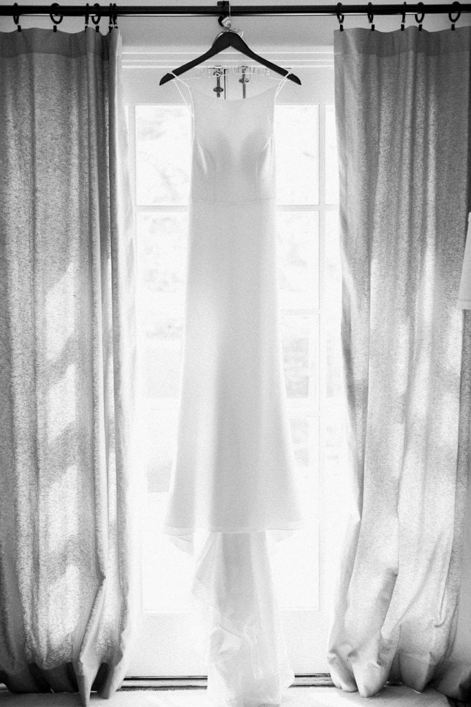 Black and white photo of brides Mikaella by Paloma Blanca wedding dress