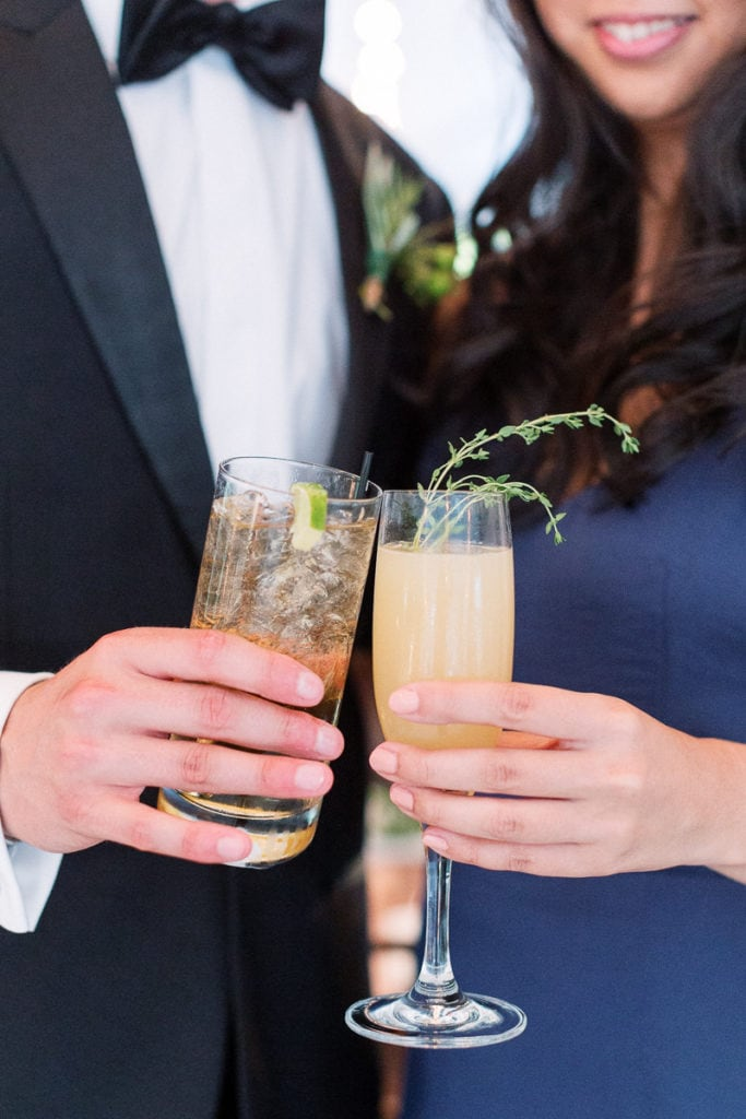 Guests holding signature cocktails during cocktail hour