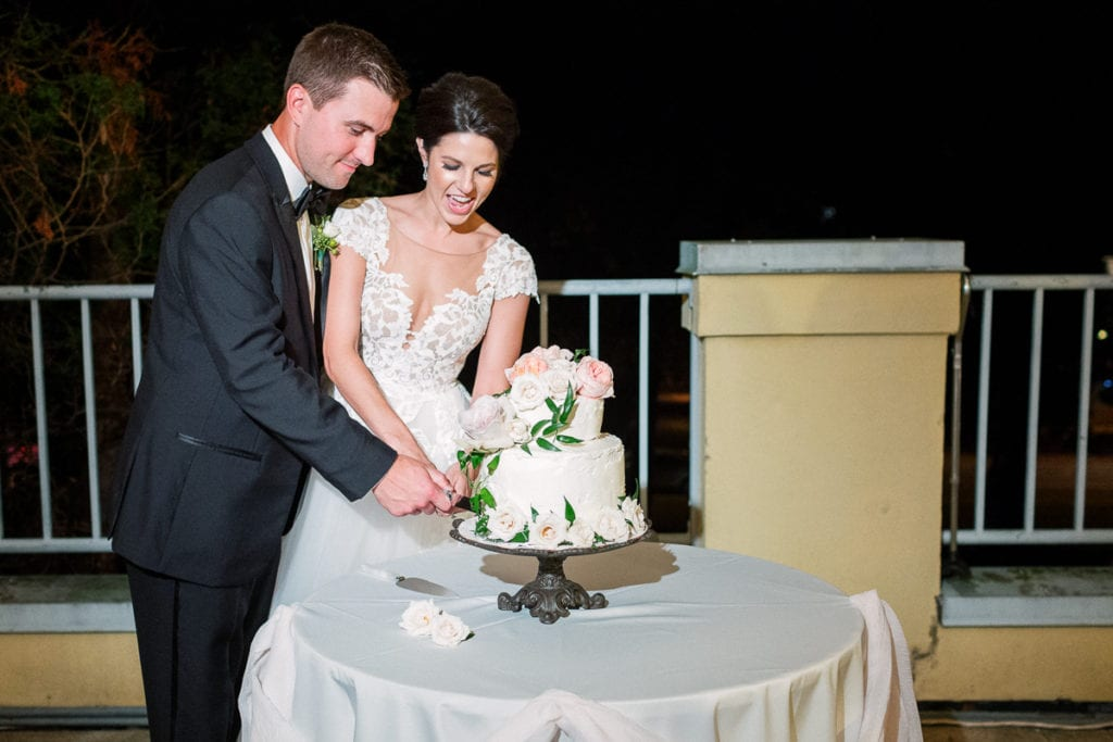 Cutting the cake at their wedding reception at the walled garden