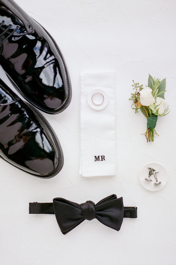 Groom's details with bow tie and cufflinks