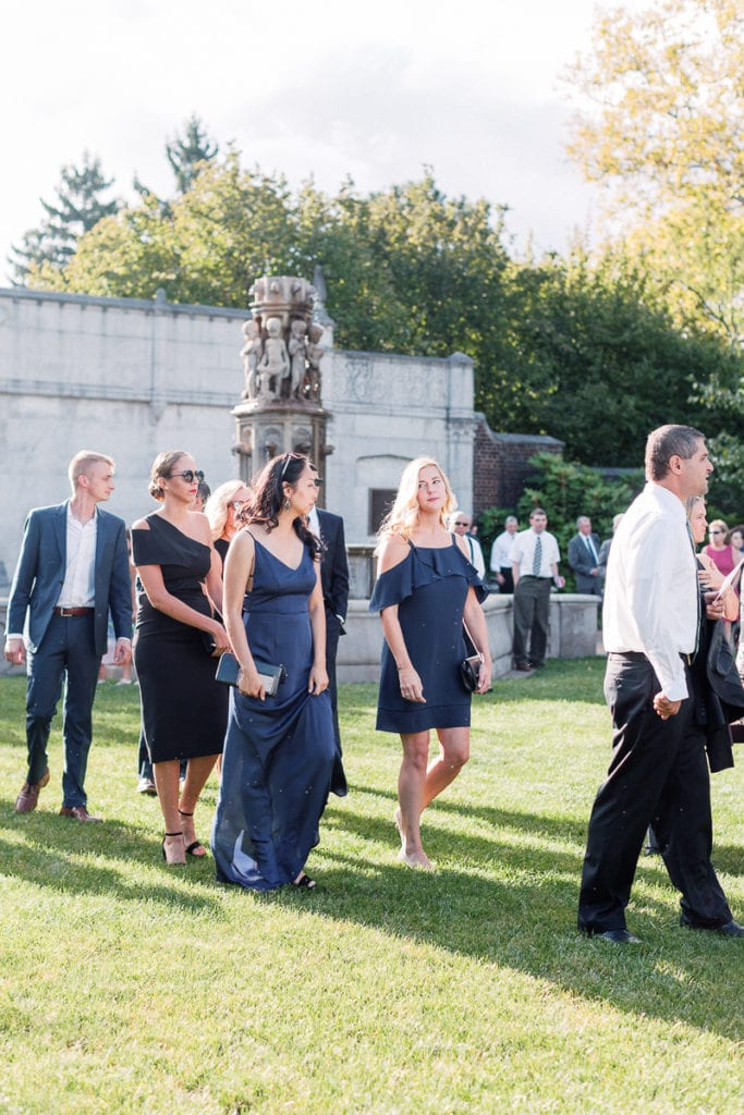 Guests as they take their seats of the wedding ceremony in the walled garden