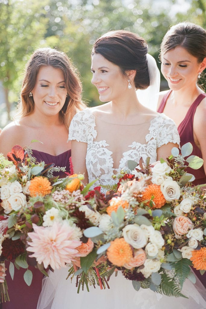 Bride with her bridesmaids holding bouquets from the Farmer's Daughter