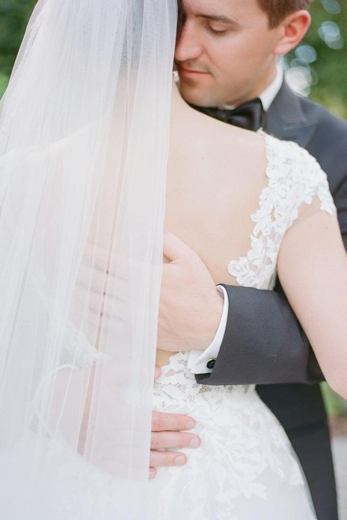 Groom nuzzling into his brides neck