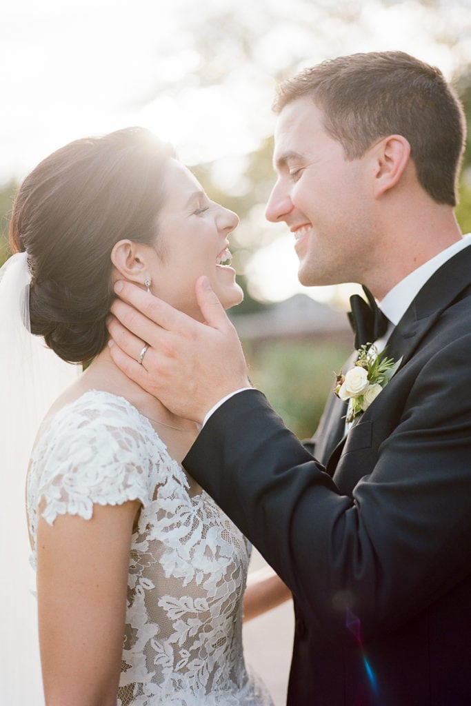Sun-kissed portrait of bride and groom in the walled garden