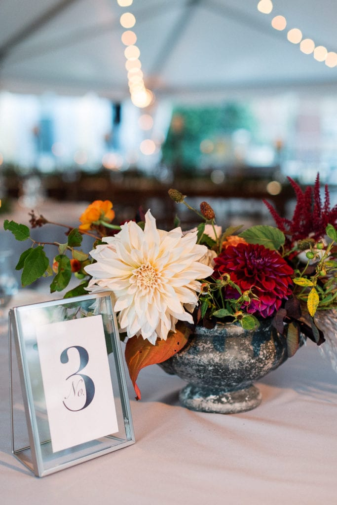 Table decor with signage and The Farmer's Daughter Flowers