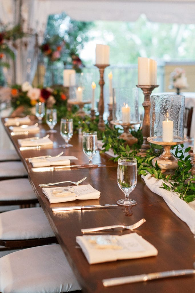 Long head table with brown chiavari chairs