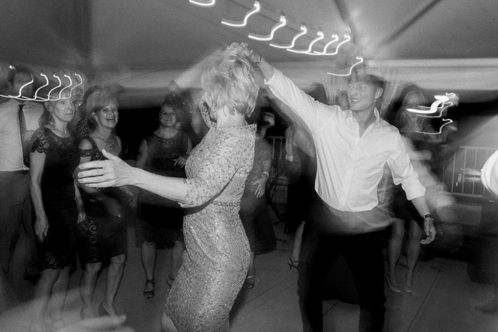 Mother of the bride dancing at wedding reception