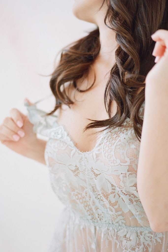 elegant bridal boudoir close up details of blue lace jumper and hair