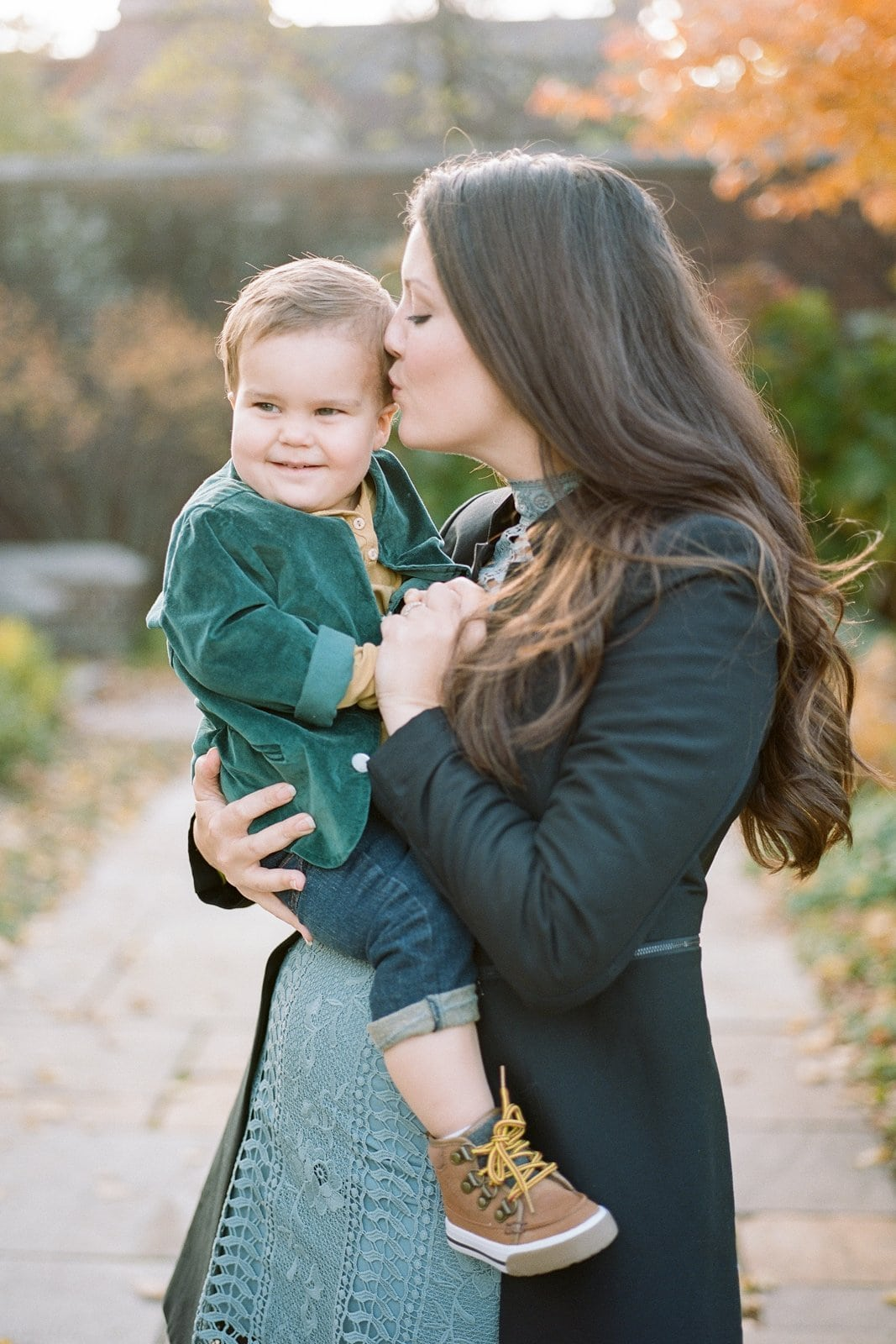 Mom kissing her young son on the head during portraits