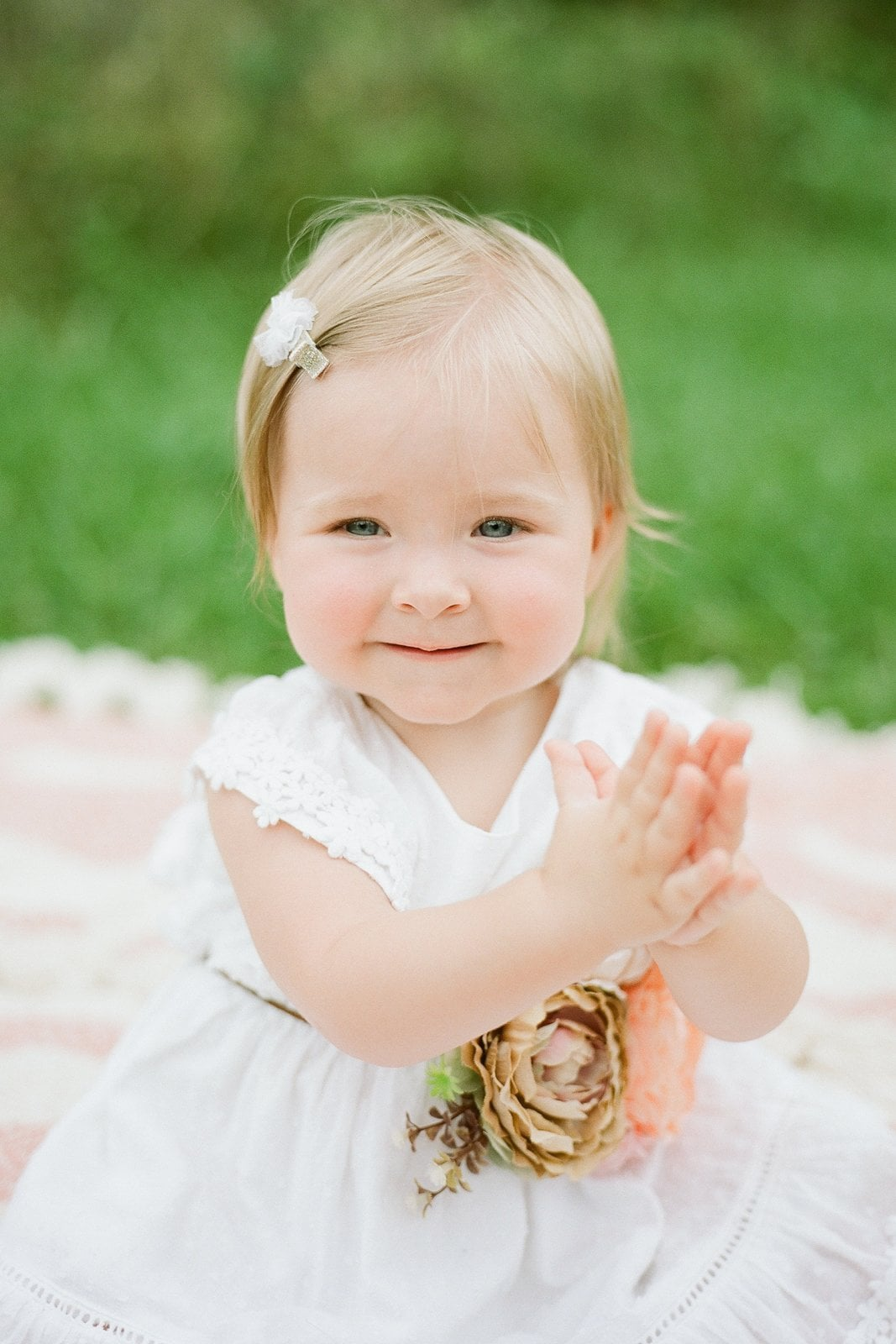 one year old photos of little girl in white dress