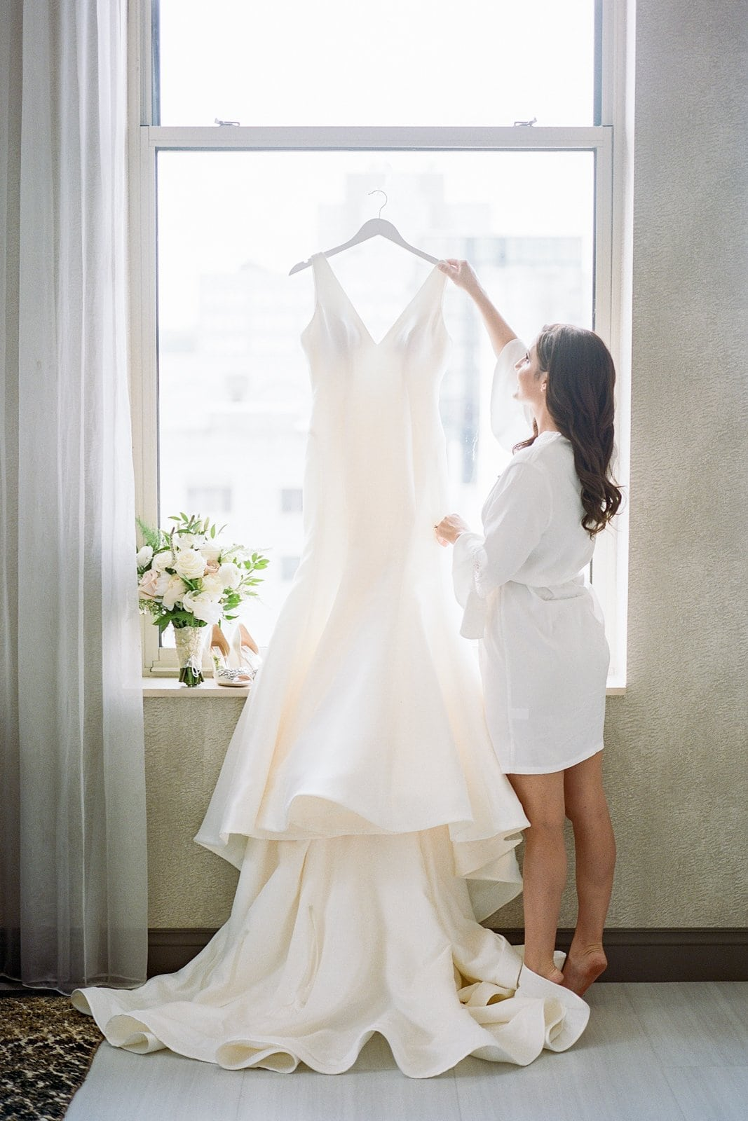 bring taking down her wedding dress to get dressed
