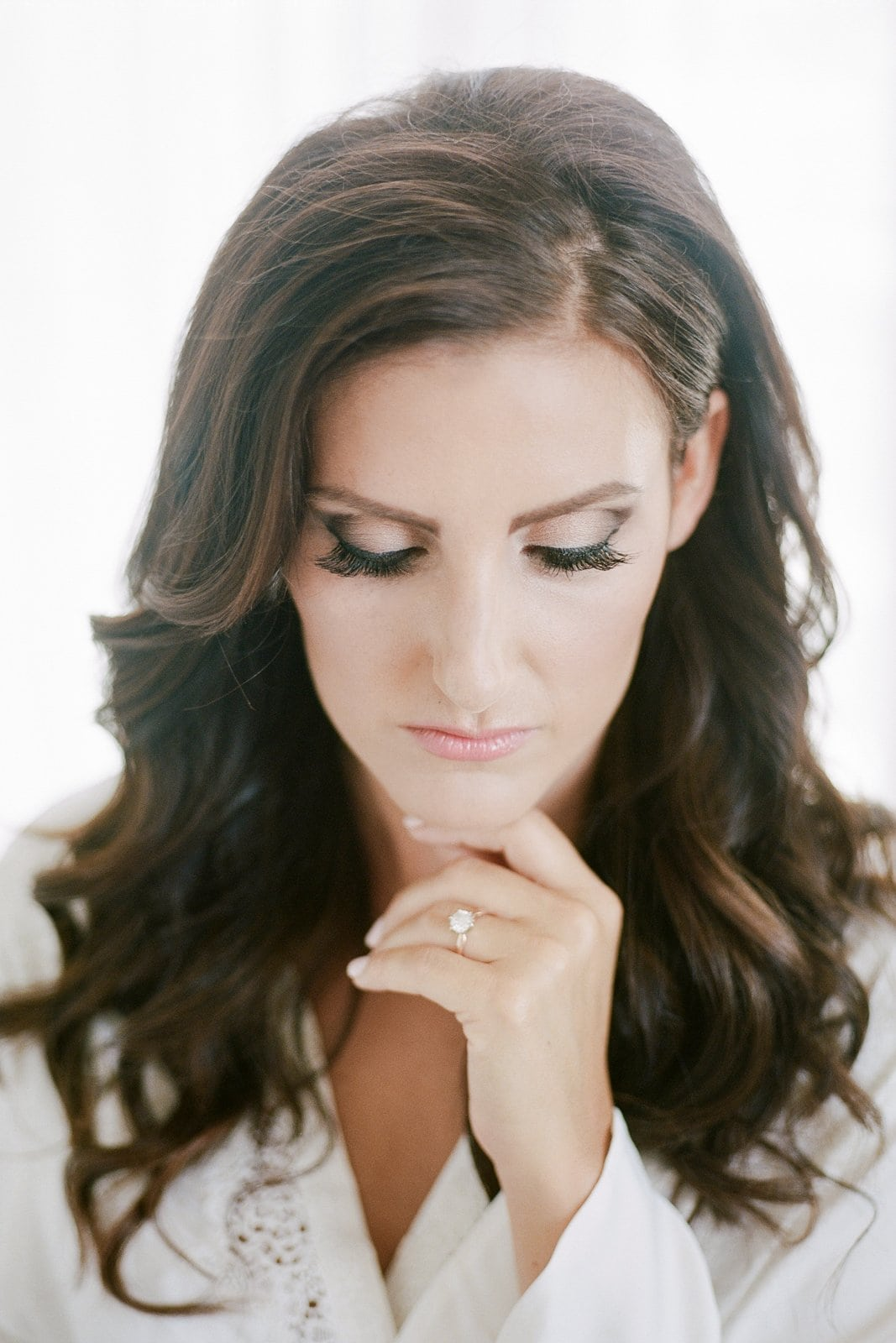 portrait of a bride getting ready in white robe