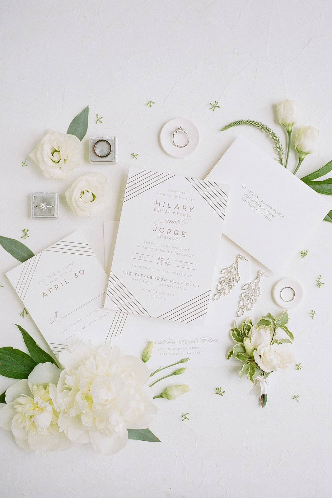 invitation suite flat lay photo with peonies and gold foil