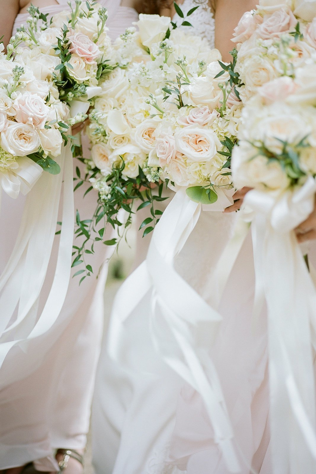 bridesmaids bouquets and ribbon blowing in the wind
